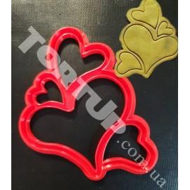 Пластиковая вырубка с оттиском 4 сердца высота 12см