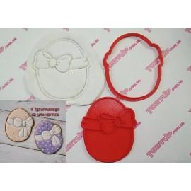 Пластиковая вырубка с оттиском Яйцо с бантиком 10см